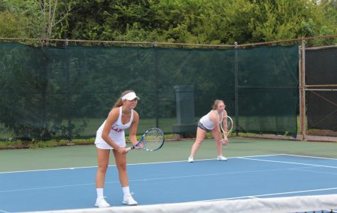 Pia Indrevoll (left), a foreign exchange student, has taken her new life in stride, joining the tennis team among other new activities.