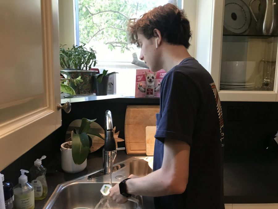 Sophomore+John+Stone+had+a+job+washing+dishes+at+The+Village+Bakery+before+the+pandemic+but+now+washes+dishes+at+home+in+quarantine