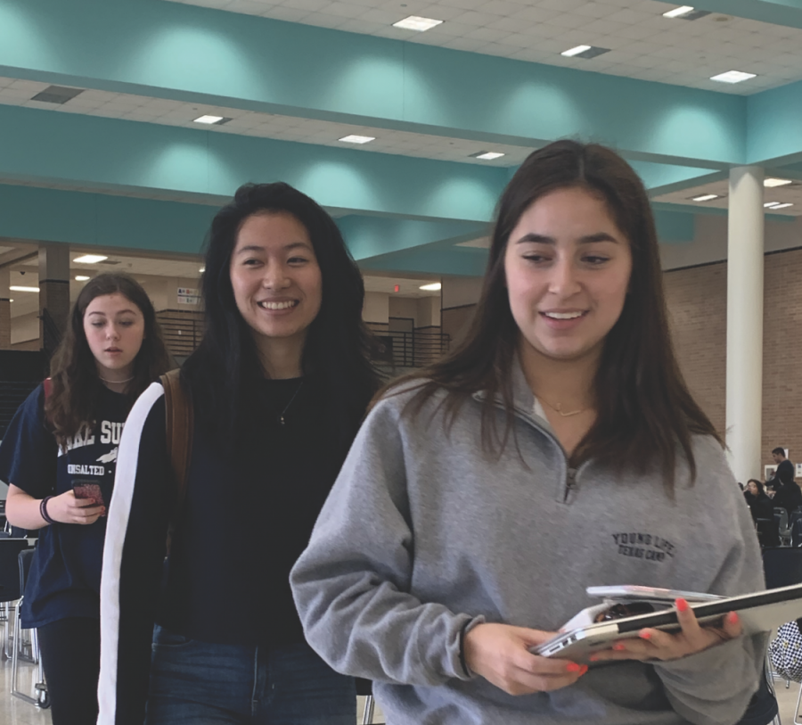 Kathryn Stone, Lauren Koong and Jillian Gonzalez walk out of one of their events at a UIL competition