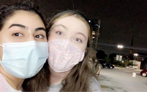 Juniors Sarah Kabouni and Kathryn Stone demonstrate the importance of wearing a mask