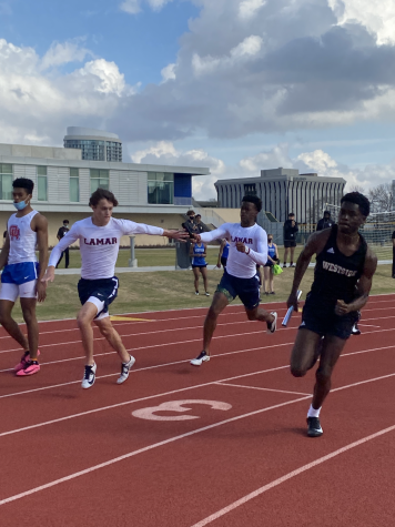 Jacoby Boykins passes the relay baton to Gage Hensey